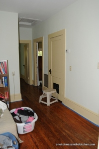 I repainted the baseboards and walls in the hallway.